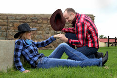 Free Fun Cowboy Couple Shoot Stock Image - 49339751