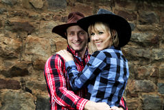 Fun cowboy couple shoot Royalty Free Stock Photo