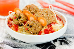 Fun and creative food for kids on Halloween - meat cutlets shape Stock Photo