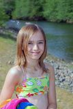 Fun at the creek. Young girl in bathing suit and beach towel at the creek Royalty Free Stock Photography