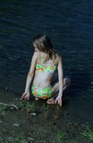 Fun at the creek. Young girl in bathing suit playing in the creek Royalty Free Stock Image