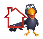 Fun Crow cartoon character with home sign Stock Images