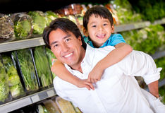Fun dad at the supermarket Stock Photos