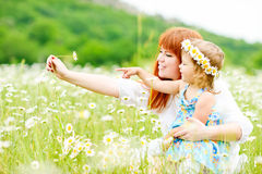 Fun in daisy field Royalty Free Stock Images