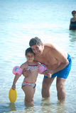 Fun day at the beach. A young girl with her father at the beach Royalty Free Stock Image