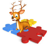 Fun Deer cartoon character with puzzel Stock Photo
