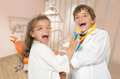 Fun at the dentist. A couple of kids playing doctor at the dentist Royalty Free Stock Photography