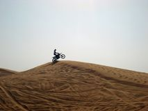 Fun in the desert. A motorcyclist doing tricks in the desert Stock Photography