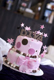 Fun Diva Cake in Bakery. A pink fondant cake with Diva and stars topping it featured in a bakery. Shallow DOF with focus on the front of the cake stock photography