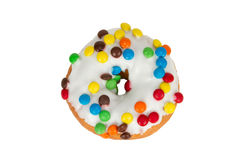 Fun Donut Isolated on a White Background. Fun Party Donut with Chocolate Candies and White Icing Isolated on White Background royalty free stock image