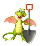 Fun Dragon cartoon character  with digging shovel Stock Photo