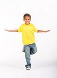 Fun eastern boy. A fun eastern boy happily posing on white background Stock Photo