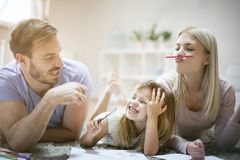 Fun and education. Family at home. stock photo