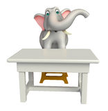 Fun  Elephant cartoon character  with  table and chair Royalty Free Stock Photo
