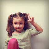 Fun emotion kid girl with good idea showing finger up. Closeup p Royalty Free Stock Image