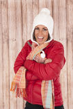 Fun expression female model sticking tongue out in winterwear Stock Images