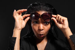 Fun expression by young girl wearing sunglasses royalty free stock photos