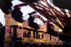 Fun fair. View of laught fun fair through shadows of speed fun fair Royalty Free Stock Images