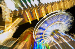 Fun Fair. Abstract ferris wheel and chairoplane in the night Stock Images