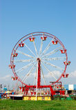 Fun fair. Generic fairground with fun fair wheel, no recognizable people Royalty Free Stock Photography