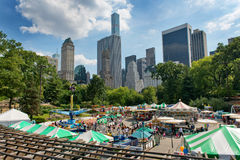 Fun fair in a clearing in Central Park, NYC Royalty Free Stock Photography