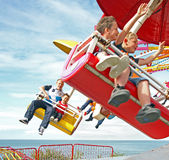 Fun at the fairground. Photo of families enjoying an umbrella ride at whitstable funfair on 16th june 2013 Stock Photo