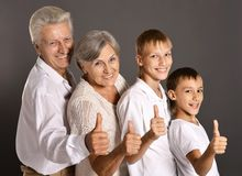 Fun family with thumbs up Royalty Free Stock Photo