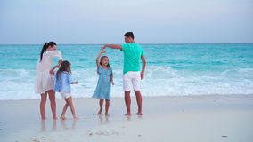 Fun family vacation on the beach stock video footage