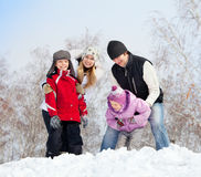 Fun family in winter park. Happy family with children in winter park Stock Photography