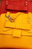 Fun with fashion. Detail of leather handbags, market San Lorenzo, Florence Stock Photo