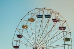 Fun ferris wheel. Vintage colorful ferris wheel over blue sky Royalty Free Stock Photography