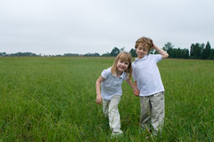 Fun in the field. Boy girl twins out in the field Stock Photo