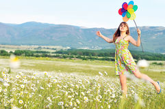 Fun in field of daisies Stock Photos