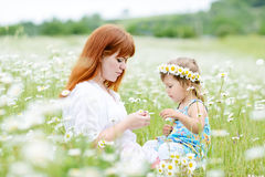 Fun in field of daisies Royalty Free Stock Photography