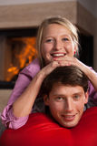 Fun by fireplace Royalty Free Stock Image