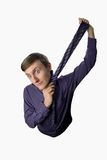 Fun fisheye a look on young businessman who tries to tie one's tie on white background Royalty Free Stock Photos