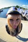 Fun fisheye view on girl looking as seamen.  Royalty Free Stock Images