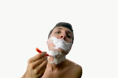 Fun fisheye view of the young man who has a shave on white background Stock Photos