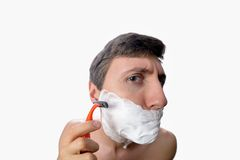 Fun fisheye view of the young man who has a shave on white background Stock Photo