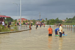 Fun in Flood Water. Villagers having fun with their families in the flood water. Heavy rains cause irregular flood in Rantau Panjang, Malaysia - Thai borders Stock Images