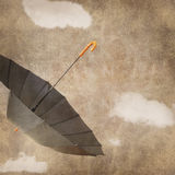 Fun flying umbrella Stock Image