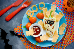Fun food art idea for baby food - stuffed bell pepper mummy with Royalty Free Stock Images