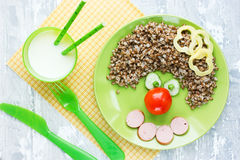 Fun food art for kids - buckwheat with sausage and vegetables sh Stock Image