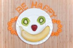 Fun food. Banana smile. Food for kids royalty free stock photography