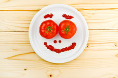 Fun food for children - tomatoes making smiley face Royalty Free Stock Photo