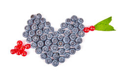 Fun food. Heart and arrow made from fruits Stock Photography