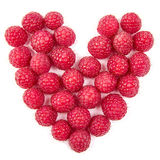 Fun food. Heart made from raspberry Stock Photos