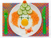 Fun food idea for kids - fried egg vegetables clown face Stock Photography