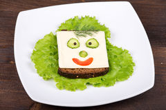 Fun food for kids - face on bread Stock Images