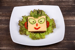Fun food for kids - face on bread Royalty Free Stock Image